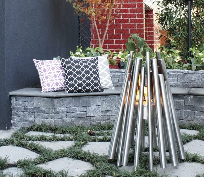An outdoor bioethanol fire next to a bench seat - are bioethanol fires easy to install?