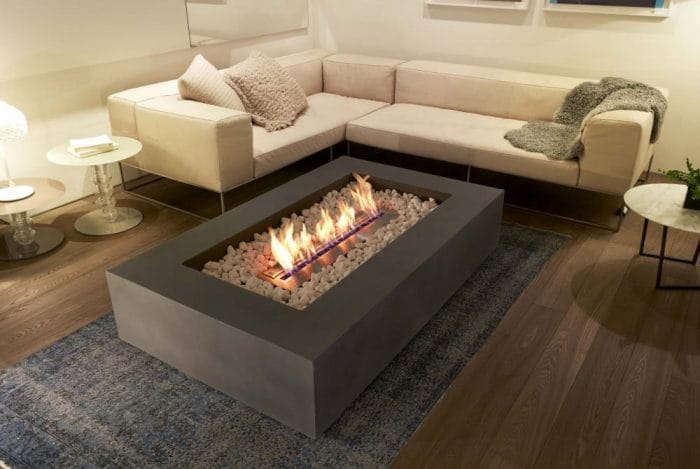 are bioethanol fires safe indoors? Image shows a large indoor bioethanol fire surrounded by sofas