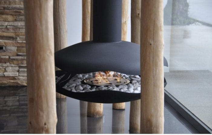 What are bioethanol fires? Image shows a modern fire suspended from the ceiling by a simple black flue